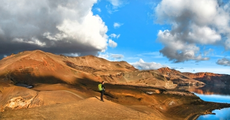 crater highlands: Panoramic view of beautiful geothermal landscape with woman standing on mountain top near Askja crater lake, South Iceland