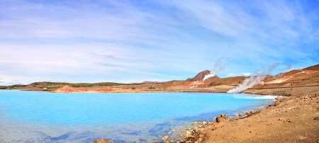 hot springs: Panoramic view of geothermal landscape with beautiful azure blue crater lake, Myvatn area, north of Iceland Stock Photo