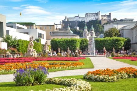 the famous: Beautiful view of famous Mirabell Gardens with the old historic Fortress Hohensalzburg in the background in Salzburg, Austria