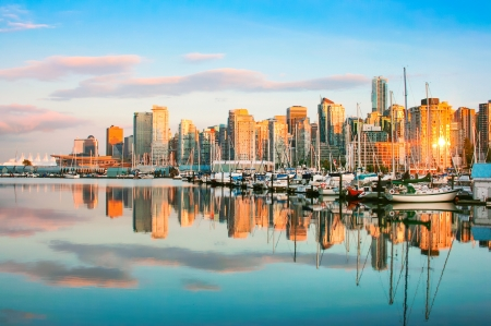 Beautiful view of Vancouver skyline with harbour at sunset, British Columbia, Canada photo