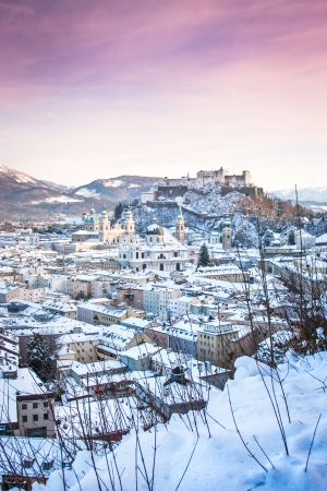 Beautiful view of the historic city of Salzburg with Festung Hohensalzburg in winter, Salzburger Land, Austria photo