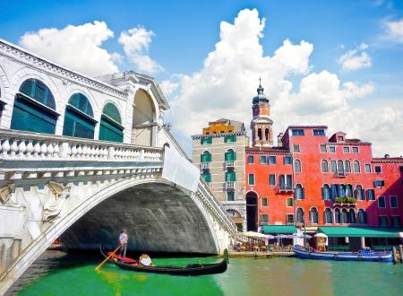 Famous Ponte di Rialto with traditional Gondola under the bridge in Venice, Italy Stock Photo - 20215296