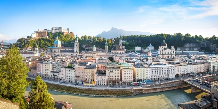 Panoramic view of Salzburg skyline with river Salzach at sunset as seen from Kapuzinerberg in Salzburg, Salzburger Land, Austria photo