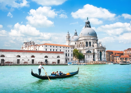 Gondola on Canal Grande with Basilica di Santa Maria della Salute in the background, Venice, Italy photo