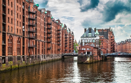 Panoramic view of famous Speicherstadt with dark clouds before the storm in Hamburg, Germany. photo