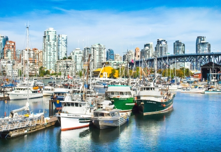 port stanley: Beautiful view of Vancouver skyline with Granville bridge and ships lying in harbor at False Creek, British Columbia, Canada