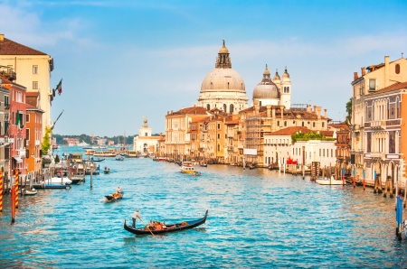 Beautiful view of famous Canal Grande and Basilica di Santa Maria della Salute at sunset in Venice, Italy