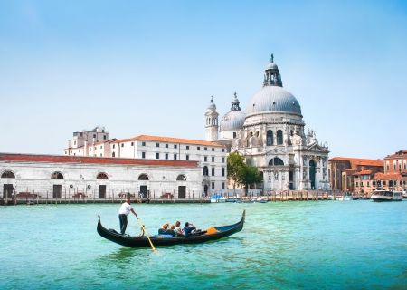 Gondola on Canal Grande with Basilica di Santa Maria della Salute in the background, Venice, Italy Stock Photo