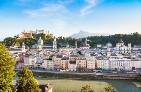 Panoramic view of Salzburg skyline with river Salzach at sunset as seen from Kapuzinerberg, Salzburger Land, Austria photo