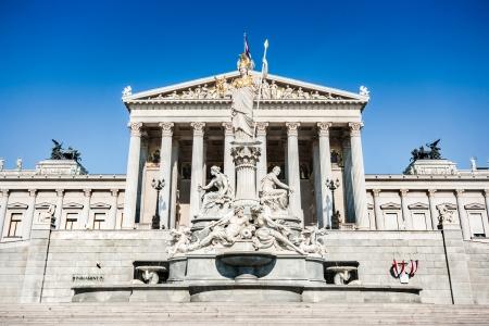 pallas: Austrian parliament building with famous Pallas Athena fountain in Vienna, Austria Stock Photo