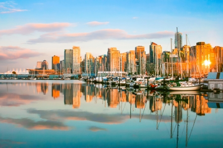 waterfront property: Beautiful view of Vancouver skyline with harbor at sunset, British Columbia, Canada