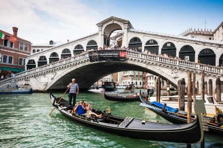 rialto bridge: Traditional Gondolas on Canal Grande with famous Rialto bridge in the background, Venice, Italy