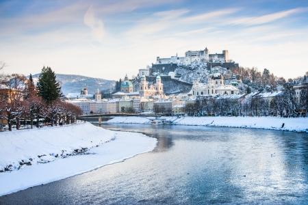 salzach: Beautiful view of Salzburg skyline with Festung Hohensalzburg and river Salzach in winter, Salzburger Land, Austria