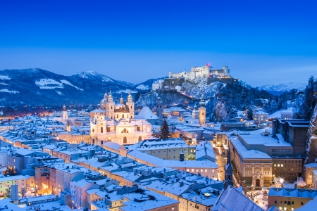 winter night: Beautiful view of the historic city of Salzburg with Festung Hohensalzburg in winter, Salzburger Land, Austria