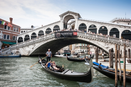 Traditional Gondolas on Canal Grande with famous Rialto bridge in the background, Venice, Italy