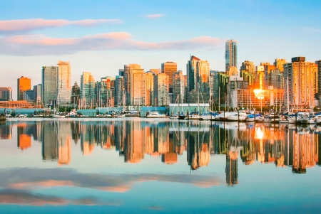 bc: Beautiful view of Vancouver skyline with harbor at sunset, British Columbia, Canada