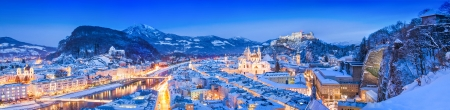 Panoramic view of the historic city of Salzburg with Festung Hohensalzburg and river Salzach in winter, Salzburger Land, Austria photo