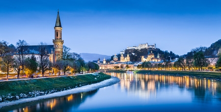 Beautiful view of Salzburg skyline with Festung Hohensalzburg and Salzach river at blue hour, Salzburger Land, Austria photo