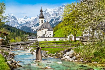 Scenic mountain landscape in the Bavarian Alps with famous Parish Church of St  Sebastian in the village of Ramsau, Nationalpark Berchtesgadener Land, Upper Bavaria, Germany photo