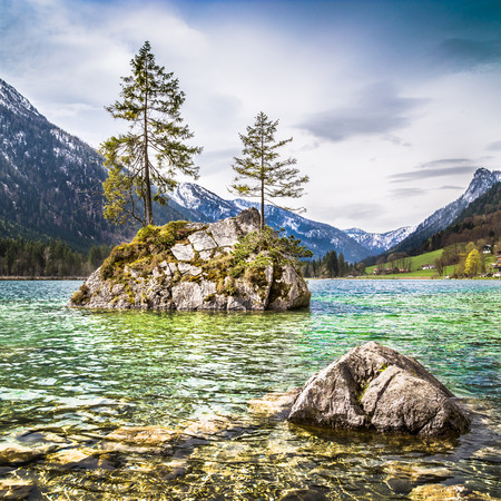 berchtesgaden: Idyllic landscape with trees on a rock at lake Hintersee, Nationalpark Berchtesgadener Land, Bavaria, Germany