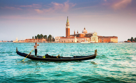 Beautiful view of traditional Gondola on Canal Grande with San Giorgio Maggiore church in the background at sunset, San Marco, Venice, Italy