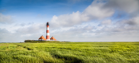 Beautiful landscape with famous Westerheversand lighthouse in the background at North Sea in Nordfriesland, Schleswig-Holstein, Germany Stock Photo