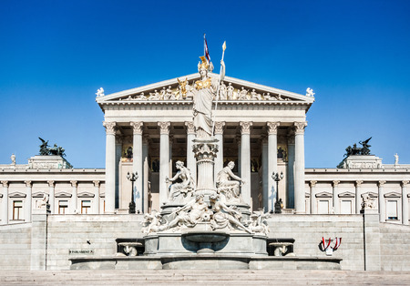 Panoramic view of Austrian parliament building with famous Pallas Athena fountain in Vienna, Austria photo