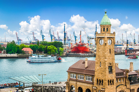 Famous Hamburger Landungsbruecken with harbor and traditional paddle steamer on Elbe river, St  Pauli district, Hamburg, Germany Stock Photo