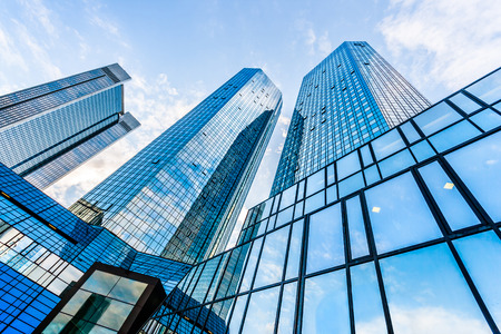 Modern skyscrapers in business district with blue sky Stock Photo