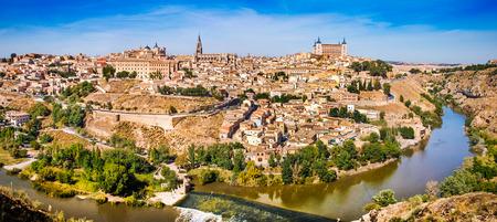spain: Panoramic view of the historic city of Toledo with river Tajo in Castile-La Mancha, Spain