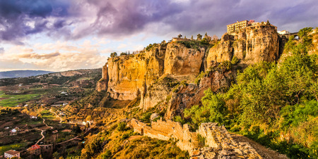 spanish landscapes: Panoramic view of the old town of Ronda, one of the famous white villages, at sunset in the province of Malaga, Andalusia, Spain