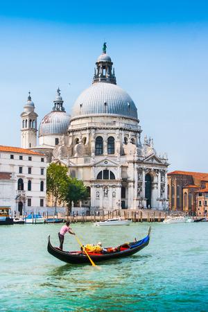 Traditional Gondola on Canal Grande with Basilica di Santa Maria della Salute in the background, Venice, Italy Standard-Bild