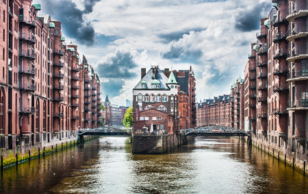 Beautiful view of famous Speicherstadt warehouse district with dark clouds before the storm in Hamburg, Germany photo