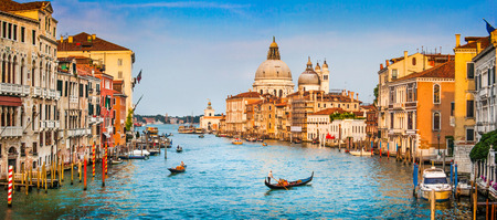 Panoramic view of famous Canal Grande and Basilica di Santa Maria della Salute at sunset in Venice, Italy