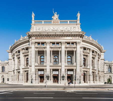 Beautiful view of historic Burgtheater with famous Wiener Ringstrasse in evening light, Vienna, Austria
