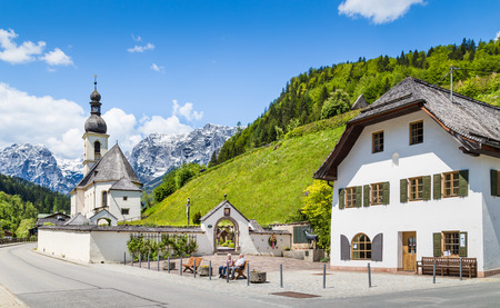 Scenic mountain landscape in the Bavarian Alps with famous Parish Church of St  Sebastian in the village of Ramsau