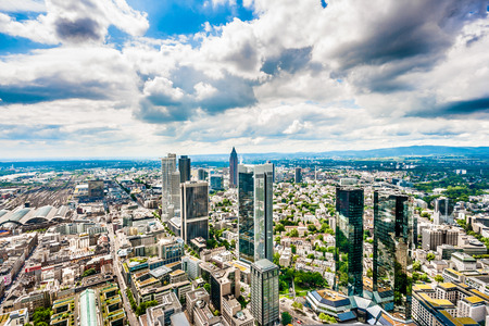 Frankfurt am Main skyline panorama with dramatic cloudscape, Hessen, Germany photo