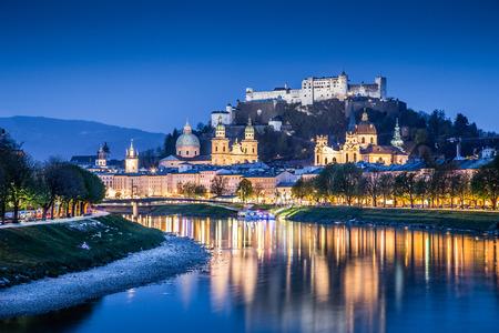 salzach: Beautiful view of Salzburg skyline with Festung Hohensalzburg and Salzach river at blue hour, Salzburger Land, Austria