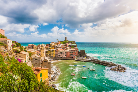 Beautiful view of Vernazza, one of the five famous fisherman villages of Cinque Terre with dramatic cloudscape in Liguria, Italy photo