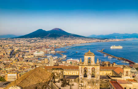 the gulf: Scenic picture-postcard view of the city of Naples with famous Mount Vesuvius  in golden evening light at sunset, Campania, Italy Stock Photo