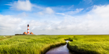 westerheversand lighthouse: Beautiful landscape with small pond and lighthouse  at North Sea in Nordfriesland, Schleswig-Holstein, Germany