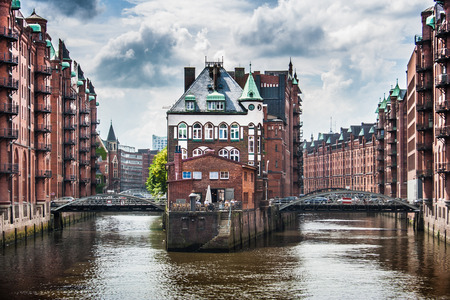 Famous Speicherstadt warehouse district with dark clouds before the storm in Hamburg, Germany