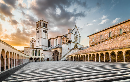 franciscan: Famous Basilica of St. Francis of Assisi with Lower Plaza at sunset, Assisi, Umbria, Italy