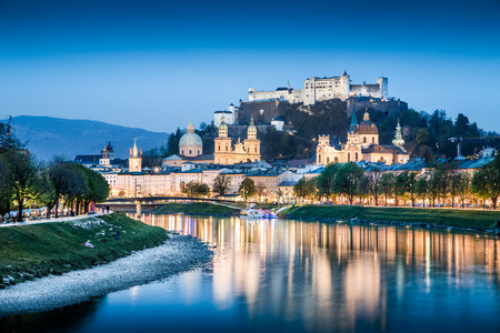 Salzburg skyline with Festung Hohensalzburg and Salzach river at blue hour, Salzburger Land, Austria photo
