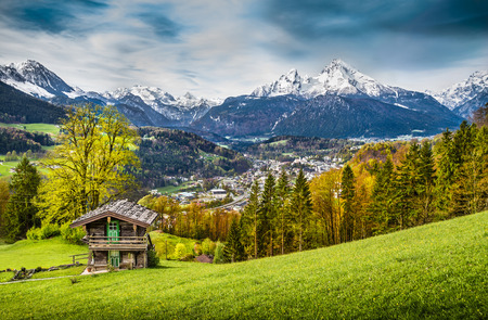 Beautiful mountain landscape in the Bavarian Alps with village of Berchtesgaden and Watzmann massif in the background at sunrise, Nationalpark Berchtesgadener Land, Bavaria, Germany photo