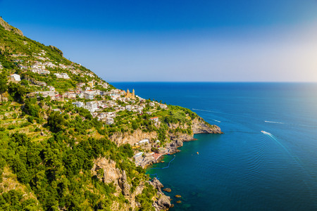 Scenic picture-postcard view of famous Amalfi Coast with Gulf of Salerno in beautiful evening light, Campania, Italy photo