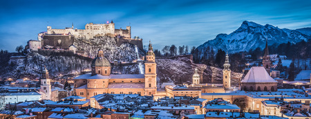 Panoramic view of the historic city of Salzburg with Hohensalzburg Fortress in winter at blue hour, Salzburger Land, Austria photo