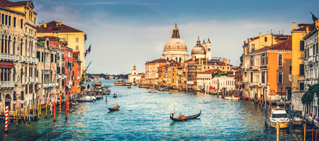 Panoramic view of famous Canal Grande and Basilica di Santa Maria della Salute at sunset in Venice, Italy with retro vintage effect Фото со стока
