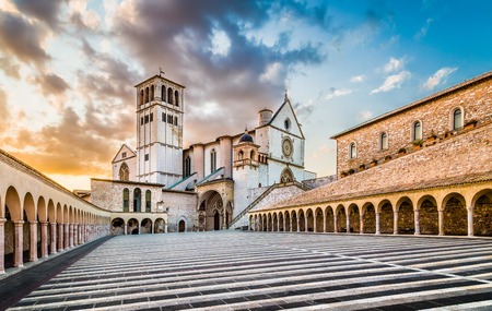 st  francis: Famous Basilica of St. Francis of Assisi with Lower Plaza at sunset, Assisi, Umbria, Italy
