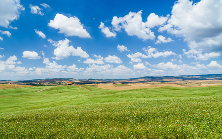 panoramic sky: Scenic Tuscany landscape with rolling hills and beautiful cloudscape in Val d Orcia, Italy Stock Photo